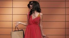 Smiling young woman with shopping bags Stock Footage