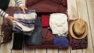 Getting ready for a trip and packing a baggage Stock Footage