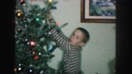 1958: brother and little sister decorating their christmas tree AMES, IOWA Stock Footage