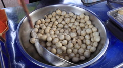 Deep frying fishball in the pan Stock Footage
