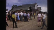 1958: people are seen in a tourist area and are observing a building COLORADO Stock Footage