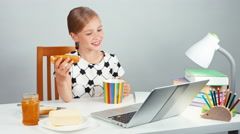 Portrait school girl 7-8 years eating sandwich with butter and jam Stock Footage