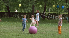 Kids Playing with Toy Balls at the Outdoor Party Stock Footage