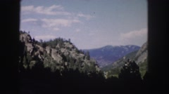 1958: a beautiful mountain ridge as seen through the window of a moving vehicle Stock Footage