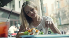 Relaxed businesswoman having a break in outdoor cafe and eating lunch Stock Footage