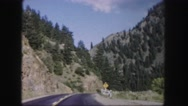 1958: traveling through the mountains on a windy road leading to nowhere Stock Footage