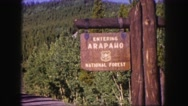 1958: rustic entrance sign for the beautiful arapaho national forest COLORADO Stock Footage