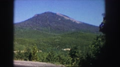 1958: large mountain under the blue sky beyond amazing greenery COLORADO Stock Footage