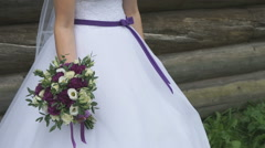 Beautiful bride holding a wedding bouquet Stock Footage