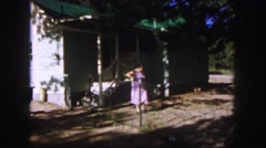 1958: ladie coming out her garage COLORADO Stock Footage