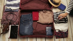 Packing a suitcase for a trip Arkistovideo