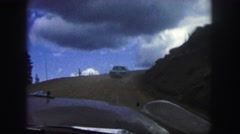 1958: a dangerous road on the side of a mountain as seen from a moving vehicle Stock Footage
