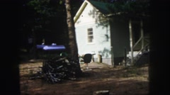 1958: a rustic unkept yard and gas tank in front of a white house COLORADO Stock Footage