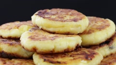 Rotation healthy homemade cheese pancakes on black background. Close up Stock Footage