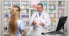 Woman Customer in Pharmacy Store Pharmacist Man Talking About Medicine Product Stock Footage