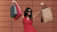 Happy young woman excited with her purchases. Slow motion Stock Footage