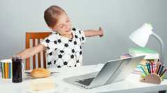 School girl 7-8 years stretching and making sandwich with butter and jam Stock Footage