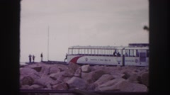 1958: subway train cars are parked on rocky jetty with several people observing Stock Footage