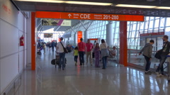 Warsaw Chopin airport terminal hallway with travellers, tourists - slow motion Stock Footage