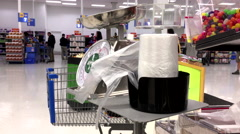 Woman taking plastic bag for buying food inside Walmart store Stock Footage