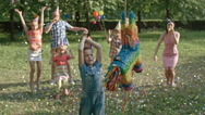 Boy Striking Pinata Stock Footage