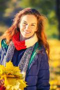 Portrait of young beautiful woman in autumn park Stock Photos