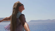 Slow mo Beautiful girl enjoying the sun and sea Stock Footage