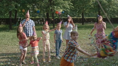 Kid Breaking Colorful Pinata Stock Footage
