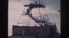 1958: people climbing down the stairs of a lookout point and a rugged landscape Stock Footage