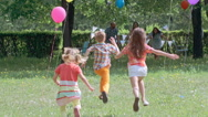 Happy Kids Running to Parents Stock Footage