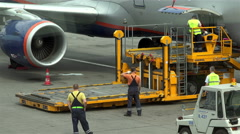 Special airport employee to alert the driver of the truck traffic airplane Stock Footage