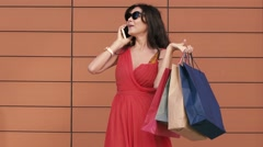 Happy young woman with shopping bags excited with her shopping day. Slow motion Stock Footage