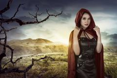 Beautiful asian girl wearing a red hooded cloak Stock Photos