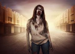 Horrible female zombies walking around the city Stock Photos