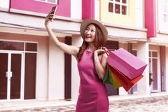 View of a young attractive asian woman with hat taking selfie Stock Photos