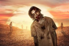 Zombie man walking in the dessert Stock Photos