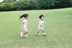 Happy Japanese kids in a city park Stock Photos