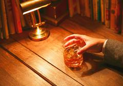 Japanese man with glass of whiskey in a fashionable bar Stock Photos