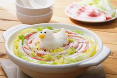 Japanese style casserole with grated radish animal decoration Stock Photos