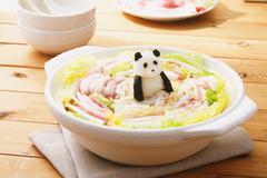 Japanese style casserole with grated radish animal decoration Stock Photos