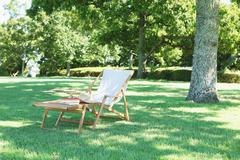 Deck chair in a city park Stock Photos