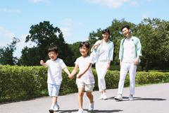 Happy Japanese family in a city park Stock Photos