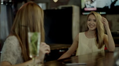 Young people talking in a bar Stock Footage