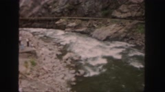 1958: a group of people watching flow of river COLORADO Stock Footage
