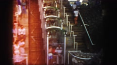 1958: people are going up the steps. they are getting in a ride that goes down Stock Footage