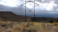 From mountain sage brush-Powerlines fade to vanishing point Stock Footage