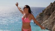 Slow mo Beautiful woman enjoying the sun and sea Stock Footage