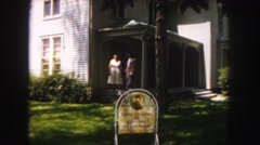 1958: a couple standing on the front porch of a boyhood home COLORADO Stock Footage