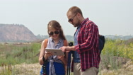 Couple Looking at Tablet on Trekking Trip Stock Footage