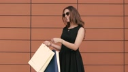 Portrait of pretty shopping girl smiling at the camera. Slow motion Stock Footage